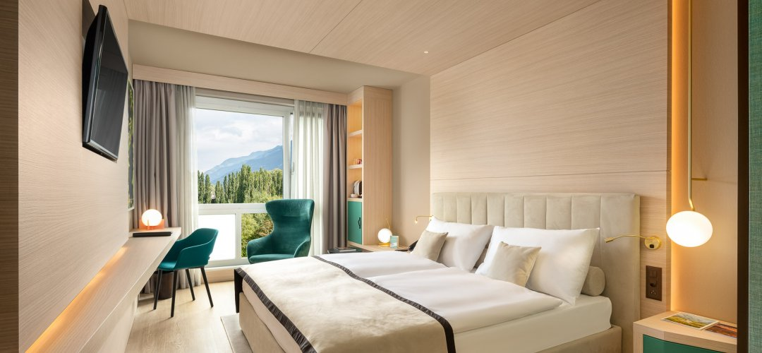 Chambre double à grand lit - Hotel Vatel Martigny
